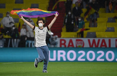 Germany fan with rainbow flag invades pitch during Hungarian anthem as row heats up