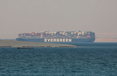 Suez Canal officials say deal reached to free seized vessel