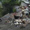 Rescuers struggle to locate dozens of residents in landslide-hit Japanese town