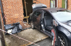 Person taken to hospital after car collides with house in Dublin 7