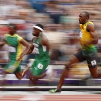 Bolt and Blake ease through 200m rounds