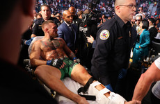 Leg injury to Conor McGregor ends trilogy bout against Dustin Poirier
