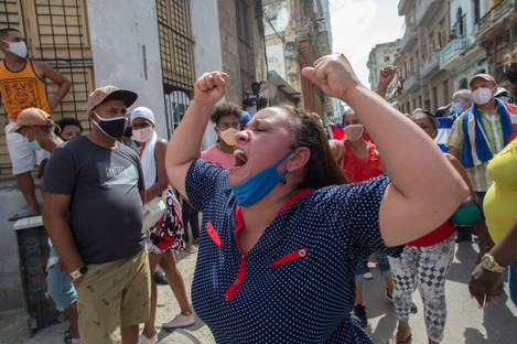 A woman shouts during an anti-government protest in Havana, Cuba