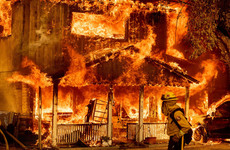 Firefighters work in searing heat as they struggle to contain biggest California wildfire of year