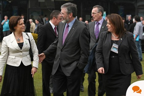 Mary Lou McDonald and Michelle Gildernew (right of Gerry Adams) have professed different attitudes to Seán Quinn - just one example of polarisation of Sinn Féin issues north and south of the border