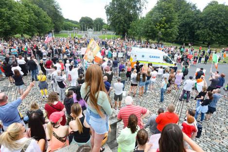Protestors outside Aras an Uachtarain in Phoenix Park, Dublin, this evening.