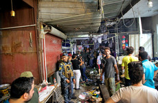 At least 30 killed in bomb attack at Baghdad market