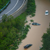 At least 25 die in floods after a year's rain fell on China province in three days