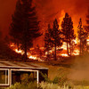 California wildfires prompt evacuations as crews continue to battle mammoth blaze