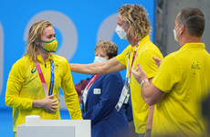 Australian swim coach apologises for tearing off mask in viral video