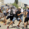 Tunisia on edge as president suspends parliament and fires prime minister