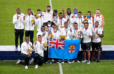 Fijian sevens team burst into a cappella song after defending Olympic title