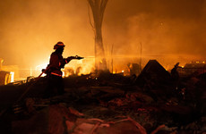 Thousands evacuate fast-moving California wildfire
