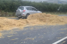 Major delays on M7 after truck carrying bales hits bridge