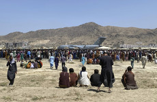 Human remains found in wheel well of US military plane following Kabul airport chaos