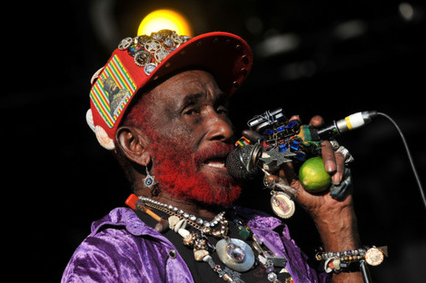 Lee 'Scratch' Perry performs during Womad Festival 2013.