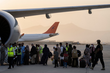 Foreigners board a Qatar Airways aircraft at the airport in Kabul, Afghanistan