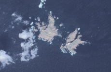 Japan may ask international court to rule on disputed islands