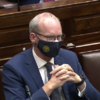 Minister Simon Coveney wins confidence vote in the Dáil by 92 votes to 59