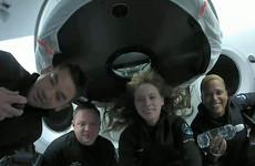 Space tourist trip to orbit ends with splashdown