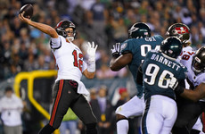 Brady shrugs off thumb injury to throw two touchdown passes as Bucs edge out Eagles