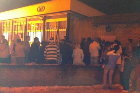 Queue outside a BOI ATM in Walkinstown, Dublin, yesterday evening.