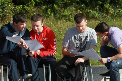 Students at St Kevin's College in Glasnevin examine their results last year. 55,815 students will receive their Leaving Cert results today.