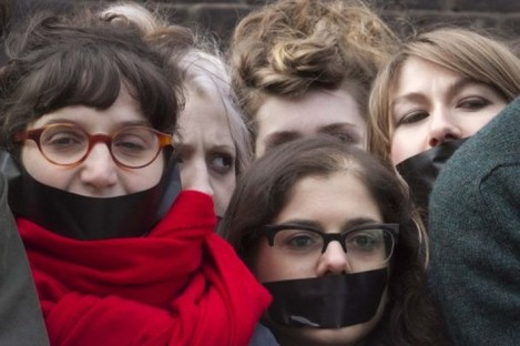 Students protest in London yesterday ahead of today's vote on tuition fees.