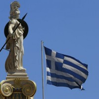 Greek PM suggests further budget cuts ahead of German talks