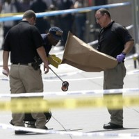 New York shooting: nine injured were all hit by police fire, say officials