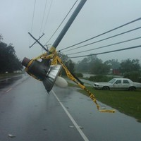 Isaac downgraded to tropical storm as curfew remains