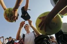 Tennis: Federer romps, Murray struggles in New York sweatshop