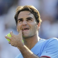 Federer into US Open last eight as Fish pulls out