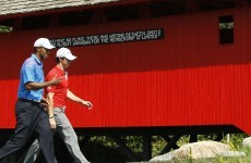 Neck and neck: Partners McIlroy and Woods in the hunt at BMW