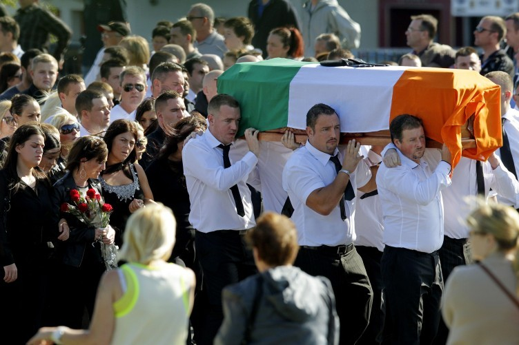 Alan Ryan's coffin is carried through Donaghmede as members of his family mourn his death earlier today.