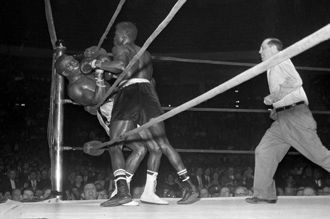 """Emile Griffith, right, sends welterweight champion Benny """"Kid"""" Paret of Cuba into the ropes just before the referee stopped their infamous world title fight."""
