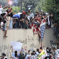 Man killed as armed mob attacks US embassies in Libya and Egypt over film