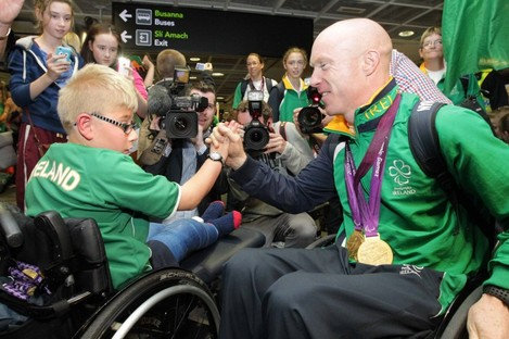Gold medallist Mark Rohan at the homecoming for Irish athletes on Monday with 9-year-old Shane Barker