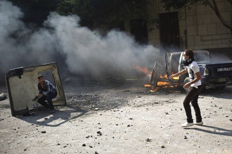 Egyptian protesters throw stones during clashes near the U.S. embassy in Cairo, Egypt.