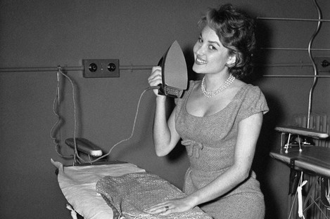 Not the face! French actress Pascale Robert trying to get the hang of this ironing lark in Paris in 1958.