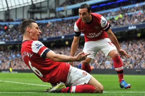 Koscielny celebrates scoring with Santi Cazorla.