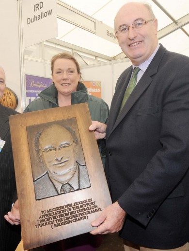 Minister Holding Portrait of Himself of the Day