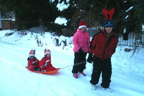The school run must go on: Jack Hartnett (12) and sister Rachel (9) take over from Rudolph to give Lucy (5) and Joseph (3) a lift to their Christmas party.
