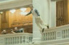 Romanian man throws himself off parliament balcony