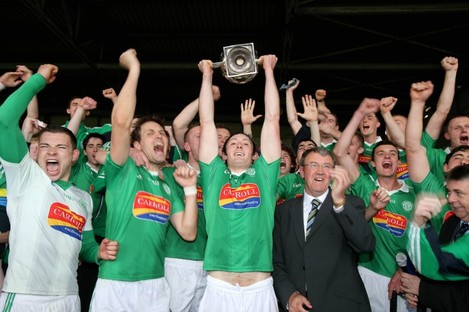 Kilmallock captain Paudie O'Brien lifts the John Daly Cup.