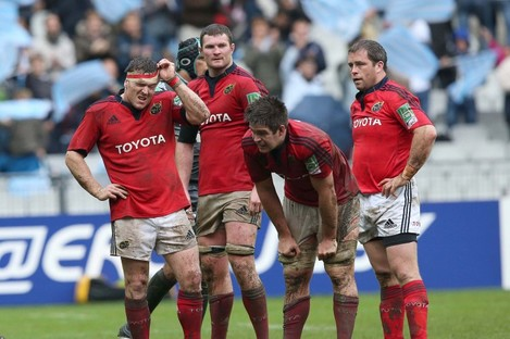 The Munster players were dejected at the final whistle.