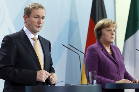 "Enda Kenny and Angela Merkel speak to reporters after a meeting in Berlin last year. The two have issued a joint statement today acknowledging Ireland's financial situation is ""a special case""."