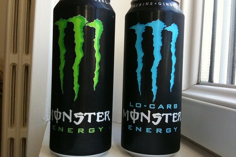 Two cans of Monster energy drink.