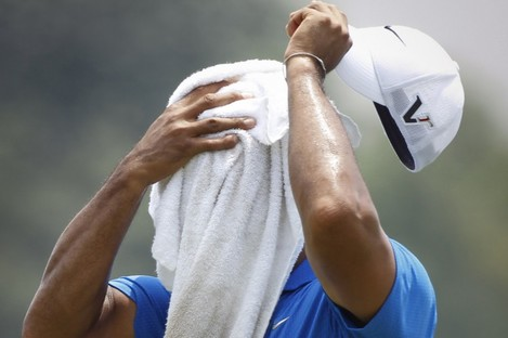Tiger Woods takes time out in Malaysia.