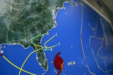 A map indicates Hurricane Sandy's position moving through the Bahamas off the east coast of Florida on Friday.